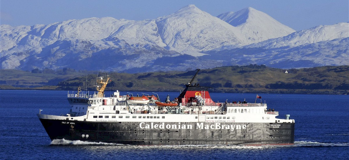 The Isle of Mull Ferry steaming to Mull  with the majestic Glencoe Hills as a backdrop